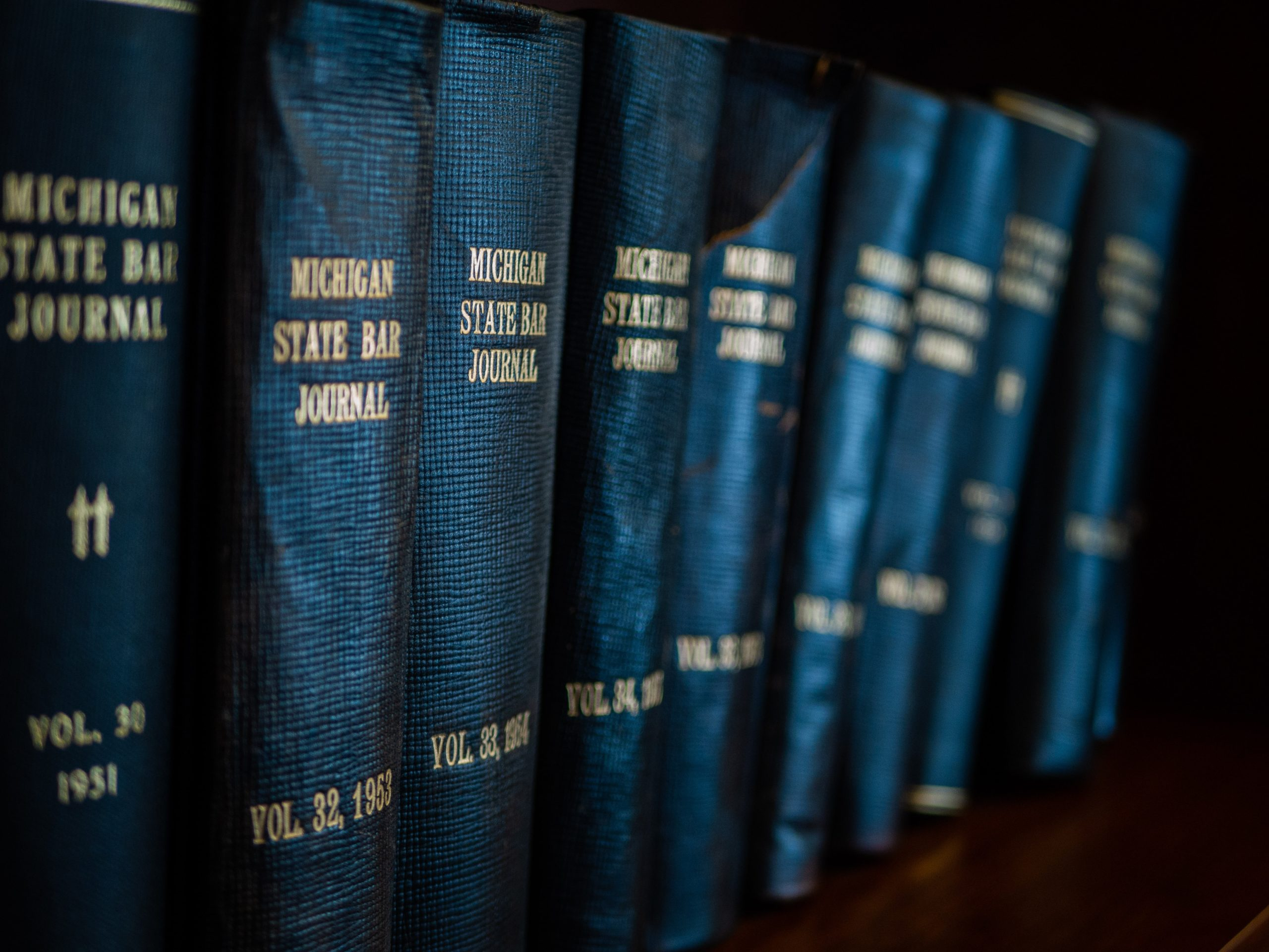 Image of blue law books to show legal hiring process